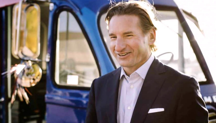 Dean Phillips In A Suitcoat W His Van 840x480